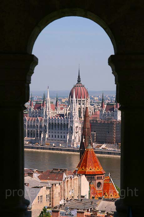 Parliament view through the arch of fishermen s bastion Budapest